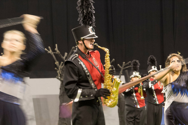 SAM HOUSEHOLDER | THE GOSHEN NEWS<br /> NorthWood saxophone player Adam Darr plays during the ISSMA State Marching Band Finals in Indianapolis Saturday.