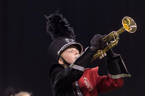 SAM HOUSEHOLDER | THE GOSHEN NEWS<br /> NorthWood eighth grade student Kristen Hochstedler plays during the ISSMA State Marching Band Finals in Indianapolis Saturday.