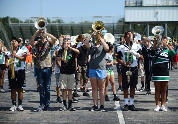 HALEY WARD | THE GOSHEN NEWS <br /> The Concord Minutemen rehearse their show during marching band practice at Concord High School.