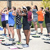HALEY WARD | THE GOSHEN NEWS <br /> Students play their flutes to warm up during marching band practice at Concord High School.