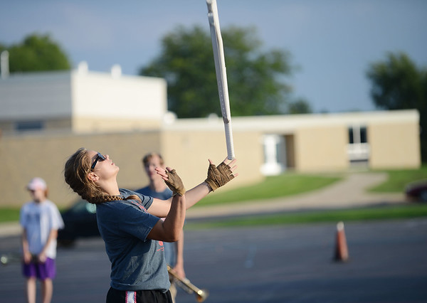 HALEY WARD | THE GOSHEN NEWS <br /> Sophomore Cara Comino tosses her rifle during marching band practice Thursday at Fairfield Jr.-Sr. High School.