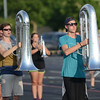 HALEY WARD | THE GOSHEN NEWS <br /> Freshman Jared Bontrager and senior Lucas Inniger march with their tubas during marching band practice Thursday at Fairfield Jr.-Sr. High School.