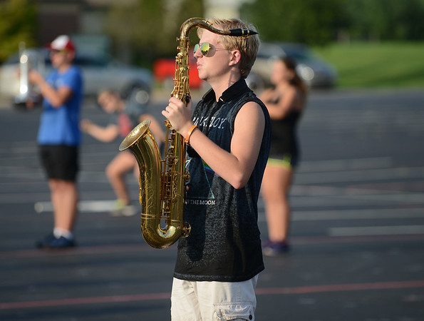 HALEY WARD | THE GOSHEN NEWS <br /> Eighth grader Chase Blucker prepares to march during marching band practice Thursday at Fairfield Jr.-Sr. High School.