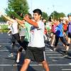 HALEY WARD | THE GOSHEN NEWS<br /> Andrew Calvillo practices the opening choreography during the Crimson Marching Band rehearsal Thursday at Goshen High School.