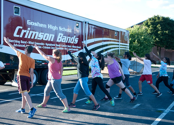 HALEY WARD | THE GOSHEN NEWS<br /> Students practice the opening choreography during the Crimson Marching Band rehearsal Thursday at Goshen High School.