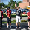 HALEY WARD | THE GOSHEN NEWS<br /> Gage Miller raises his hand while the Crimson Marching Band works on their opening choreography during the rehearsal Thursday at Goshen High School.