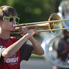 HALEY WARD | THE GOSHEN NEWS<br /> AJ Sears plays the trombone during the Crimson Marching Band rehearsal Thursday at Goshen High School.