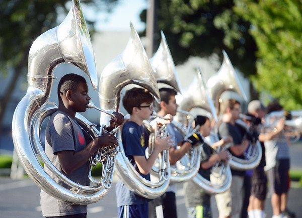 HALEY WARD | THE GOSHEN NEWS<br /> Students practice marching with their Sousaphones during the Crimson Marching Band rehearsal Thursday at Goshen High School.