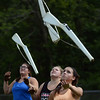 HALEY WARD | THE GOSHEN NEWS<br /> Junior Leia Earl, sophomore Ashton Rice and senior Jackie Yoder toss their rifles during the Marching Chargers' rehearsal Tuesday at NorthWood High School.
