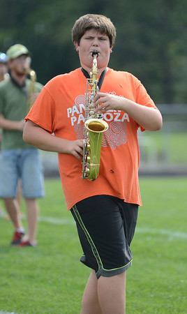 HALEY WARD | THE GOSHEN NEWS<br /> Freshman Austin Earl plays the saxophone during the Marching Chargers' rehearsal Tuesday at NorthWood High School.