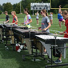 HALEY WARD | THE GOSHEN NEWS<br /> Members of the Marching Chargers' pit practices during rehearsal Tuesday at NorthWood High School.