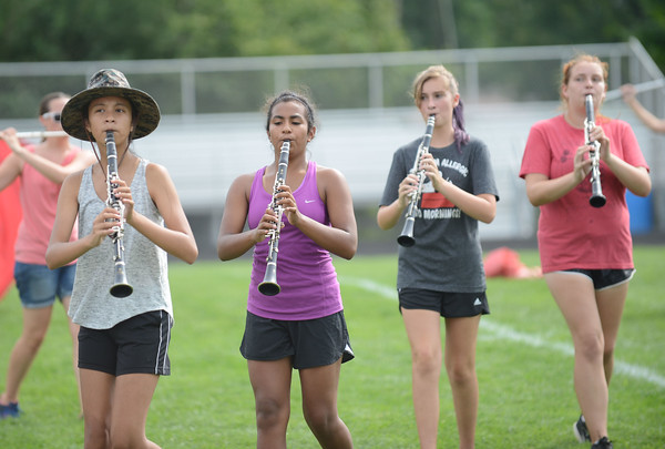 HALEY WARD | THE GOSHEN NEWS<br /> Members of the Marching Chargers play the clarinet during rehearsal Tuesday at NorthWood High School.