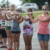 HALEY WARD | THE GOSHEN NEWS<br /> Members of the Marching Chargers play the flute during rehearsal Tuesday at NorthWood High School.
