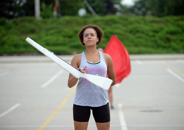 HALEY WARD | THE GOSHEN NEWS<br /> Senior Lora Wilson spins her rifle during the Marching Raiders' rehearsal Tuesday at Northridge High School.