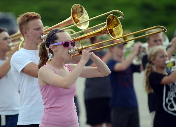 HALEY WARD | THE GOSHEN NEWS<br /> Senior Angela Skow plays the trombone during the Marching Raiders' rehearsal Tuesday at Northridge High School.