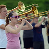 HALEY WARD | THE GOSHEN NEWS<br /> Senior Angela Skow plays the trombone during the Marching Raiders' rehearsal Tuesday at Northridge High School.