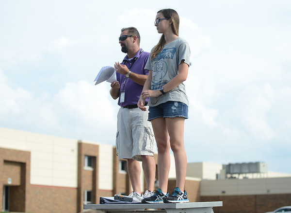 HALEY WARD | THE GOSHEN NEWS<br /> Band director Ken Brower and drum major Mandi Mall speak before the Marching Warrior Pride's rehearsal Tuesday at Wawasee High School.