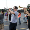 HALEY WARD | THE GOSHEN NEWS<br /> Sophomore Chris Rogers, junior Forrest Holston and senior Cedric Church play the trumpet during the Marching Warrior Pride's rehearsal Tuesday at Wawasee High School.