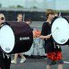 HALEY WARD | THE GOSHEN NEWS<br /> Sophomore Abby Stump and eighth grader Dakota Clark play the bass drums during the Marching Warrior Pride's rehearsal Tuesday at Wawasee High School.