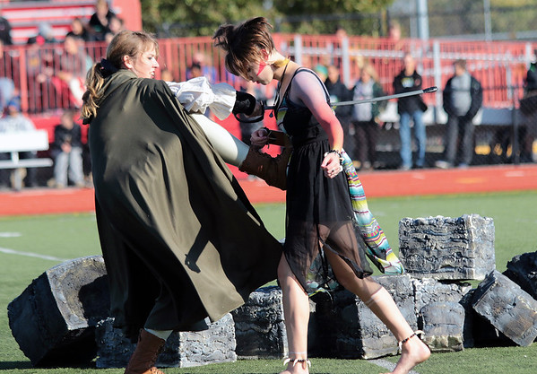 STACEY DIAMOND | THE GOSHEN NEWS<br /> Jericha Bontrager and Kala Bailey of the Wawasee High School Marching Warrior Pride perform Saturday during the Class B semistate competition.