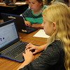HALEY WARD | THE GOSHEN NEWS<br /> Seventh grader Brenna Edwards workls on a laptop in her language arts class Monday at NorthWood Middle School.