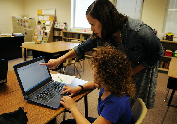 HALEY WARD | THE GOSHEN NEWS<br /> Language arts teacher Stacey Morgan helps seventh grader Morgan Jenkins with her computer Monday at Northwood Middle School.