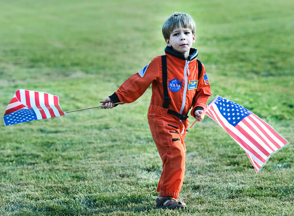 "Luke Beckett, 4, of Longmont, dances in the grass dressed in an astronaut costume on Thursday, Sept. 20, during the Scott Carpenter Park Re-dedication ceremony in Boulder. For more photos and video of the ceremony go to  <a href=""http://www.dailycamera.com"">http://www.dailycamera.com</a><br /> Jeremy Papasso/ Camera"