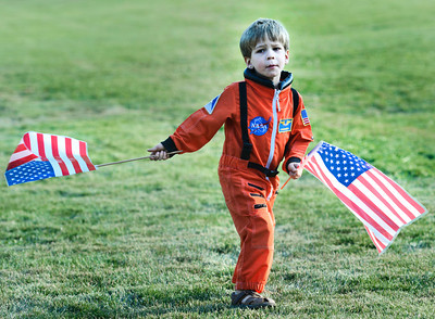 Luke Beckett, 4, of Longmont, dances in the grass dressed in an astronaut costume on Thursday, Sept. 20, during the Scott Carpenter Park Re-dedication ceremony in Boulder. For more photos and video of the ceremony go to www.dailycamera.com Jeremy Papasso/ Camera