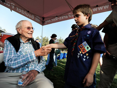 Commander Scott Carpenter, left, shakes hands with Rodney Eckler of  the Boy Scout Troop 171 on Thursday, Sept. 20, during the Scott Carpenter Park Re-dedication ceremony in Boulder. For more photos and video of the ceremony go to www.dailycamera.com Jeremy Papasso/ Camera