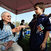 "Commander Scott Carpenter, left, shakes hands with Rodney Eckler of  the Boy Scout Troop 171 on Thursday, Sept. 20, during the Scott Carpenter Park Re-dedication ceremony in Boulder. For more photos and video of the ceremony go to  <a href=""http://www.dailycamera.com"">http://www.dailycamera.com</a><br /> Jeremy Papasso/ Camera"