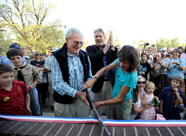 "Commander Scott Carpenter, left, Director of Parks and Recreation Kirk Kincannon, center, and the City of Boulder Deputy Mayor Lisa Morzel cut the ribbon on Thursday, Sept. 20, during the Scott Carpenter Park Re-dedication ceremony in Boulder. For more photos and video of the ceremony go to  <a href=""http://www.dailycamera.com"">http://www.dailycamera.com</a><br /> Jeremy Papasso/ Camera"