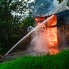 KRISTOPHER RADDER — BRATTLEBORO REFORMER<br /> Several departments responded to a second-alarm fully involved structure fire on High Street, in Spofford, N.H., on Aug. 8, 2018. Neighbors said they heard a lightning strike and then saw flames coming out from the barn on the property. The fire started around 4:50 p.m. and no one was reported in the building at the time.