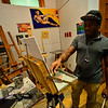 "KRISTOPHER RADDER — BRATTLEBORO REFORMER<br /> Roxcell Bartholomew, of Brattleboro, works on a painting of Brattleboro Select Board Member Shanta Lee Gander during a portrait series ""Secret Lives of Shopkeepers"" at the River Gallery on Thursday, Oct. 4, 2018."