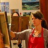 KRISTOPHER RADDER — BRATTLEBORO REFORMER<br /> Lisa Mendelsund, an art teacher at River Gallery, uses oil paints while working on a portrait of Brattleboro Select Board Member Shanta Lee Gander.