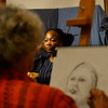 "KRISTOPHER RADDER — BRATTLEBORO REFORMER<br /> Brattleboro Select Board Member Shanta Lee Gander poses for the River Gallery's series ""Secret Lives of Shopkeepers"" while Rodrica Tilley works on a pencil drawing on Thursday, Oct. 4, 2018."