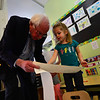 KRISTOPHER RADDER - BRATTLEBORO REFORMER <br /> United States Sen. Bernie Sanders bends over to look at the drawing by Elizabeth Howe, 3, of Brattleboro, Vt., while touring the Early Head Start room at the Brattleboro Town School District's Early Education Services, in Brattleboro, Vt., on Friday, Jan. 26, 2018.