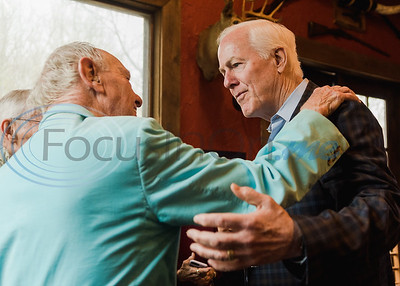 Senator John Cornyn (right) greets Dick Magner, a 93-year-old World War II veteran, during a Republican voting rally on Super Tuesday, March 3, 2020, at Texas City Music in Tyler.