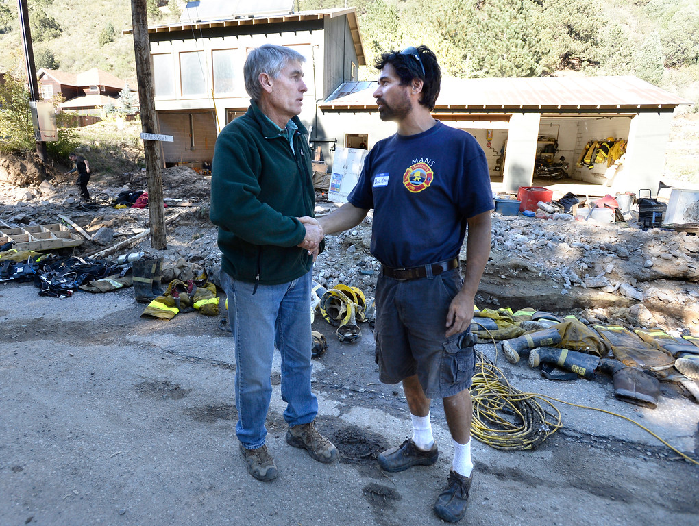 . Senator Mark Udall shakes hands with Jamestown resident and volunteer firefighter David Mans in front of the damaged fire station in Jamestown on Saturday, Sept. 28. For more photos and a video interview with Senator Mark Udall and residents of Jamestown go to www.dailycamera.com Jeremy Papasso/ Camera