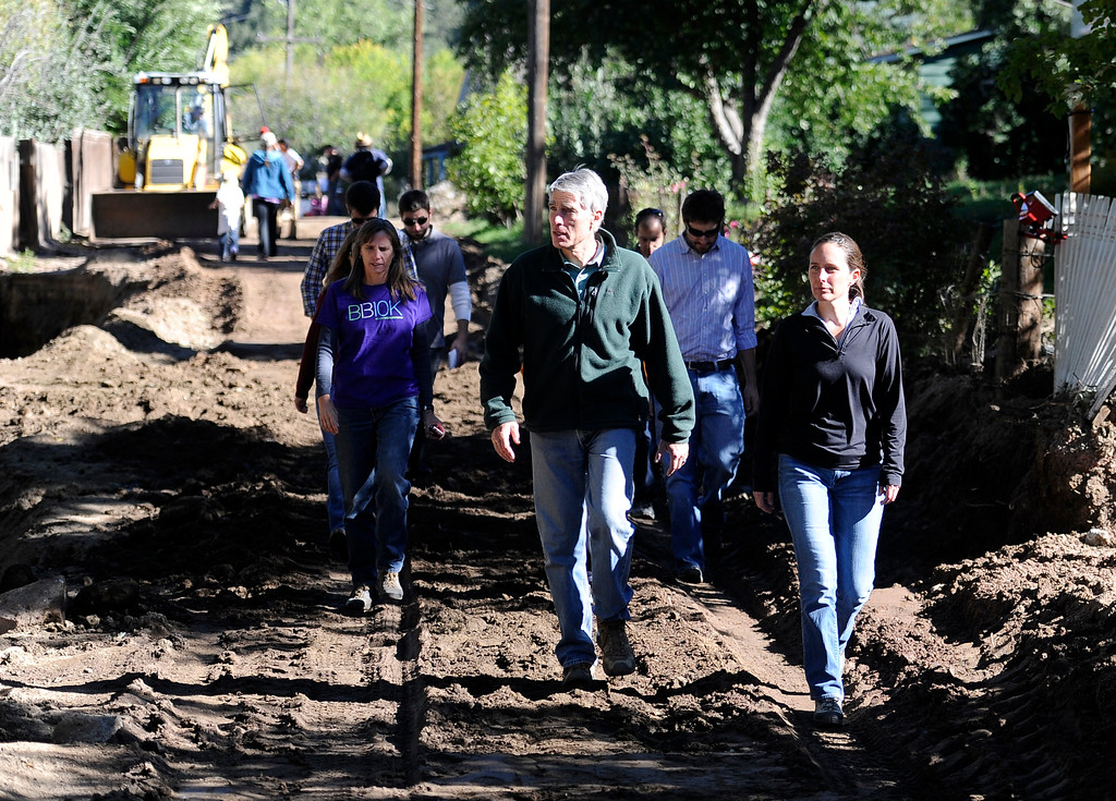 . Senator Mark Udall, center, walks through the flood damage in Jamestown with Boulder County Commissioner Elise Jones, left, and Jamestown mayor Tara Schoendinger, right, on Saturday, Sept. 28. For more photos and a video interview with Senator Mark Udall and residents of Jamestown go to www.dailycamera.com Jeremy Papasso/ Camera