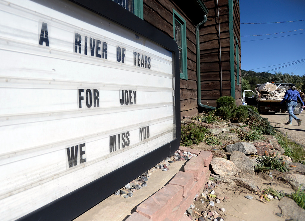 . A sign remembering former Mercantile Cafe owner Joey Howlett who died in the flood sits next to a building in Jamestown on Saturday, Sept. 28. For more photos and a video interview with Senator Mark Udall and residents of Jamestown go to www.dailycamera.com Jeremy Papasso/ Camera