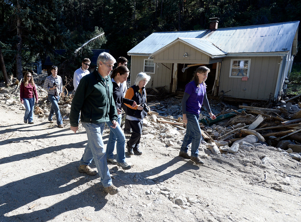 . Senator Mark Udall, at left, walks through the flood damage with Jamestown mayor Tara Schoendinger, and Boulder County Commissioners Deb Gardner and Elise Jones in Jamestown on Saturday, Sept. 28. For more photos and a video interview with Senator Mark Udall and residents of Jamestown go to www.dailycamera.com Jeremy Papasso/ Camera