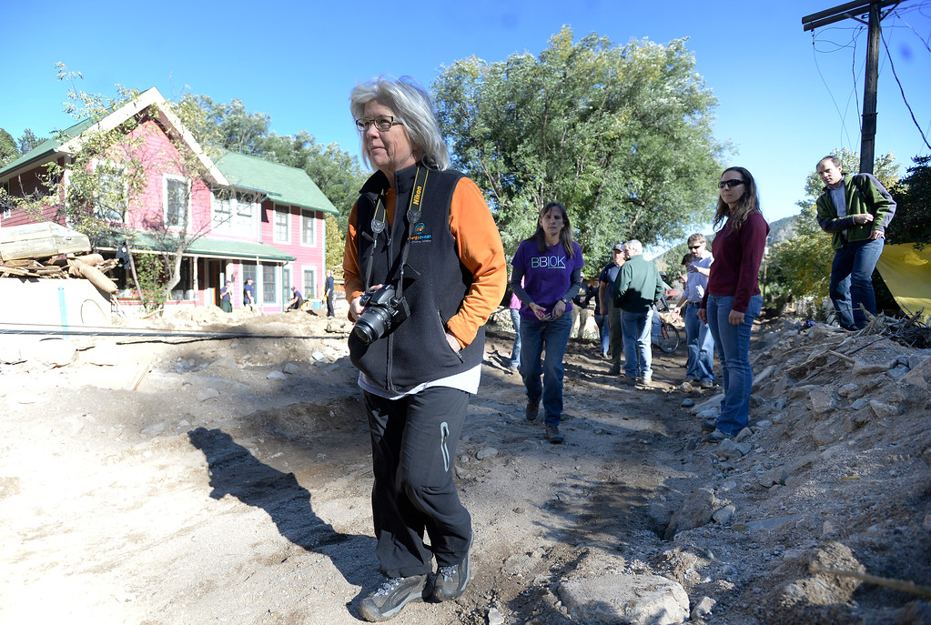 . Boulder County Commissioners Deb Gardner, left, and Elise Jones, center, walk through the flood damage with Senator Mark Udall  in Jamestown on Saturday, Sept. 28. For more photos and a video interview with Senator Mark Udall and residents of Jamestown go to www.dailycamera.com Jeremy Papasso/ Camera