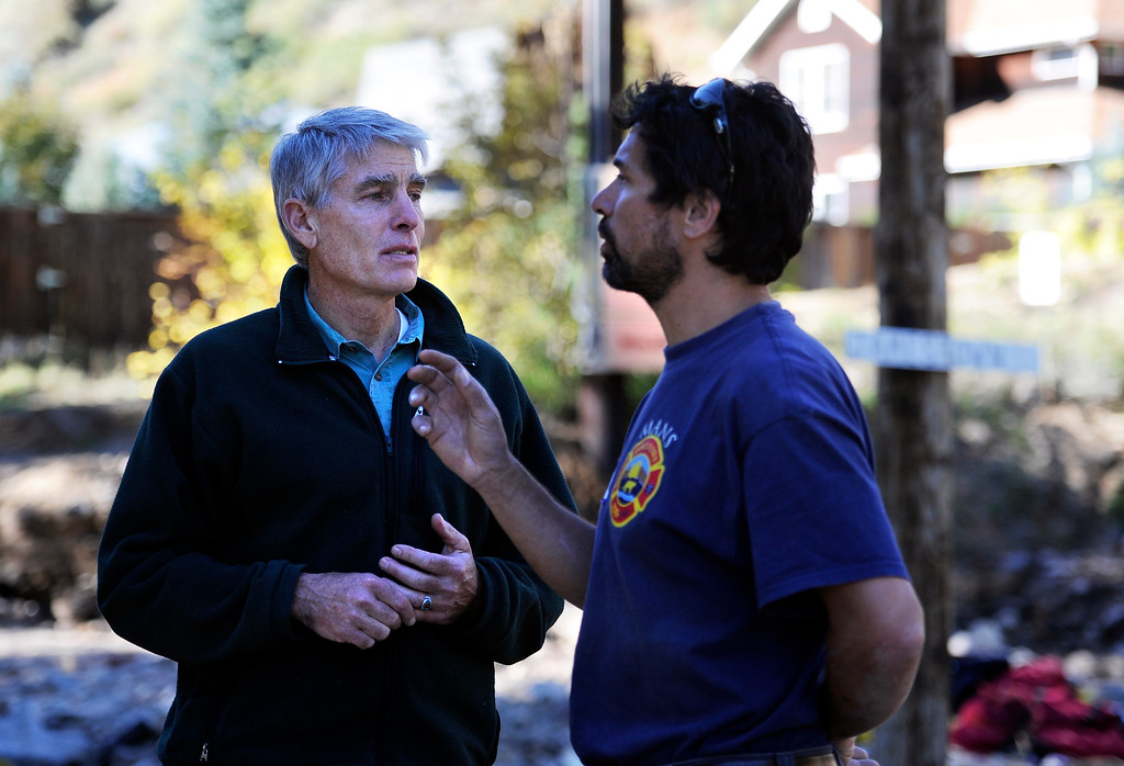 . Senator Mark Udall speaks with resident David Mans in the flood damaged town of Jamestown on Saturday, Sept. 28. For more photos and a video interview with Senator Mark Udall and residents of Jamestown go to www.dailycamera.com Jeremy Papasso/ Camera