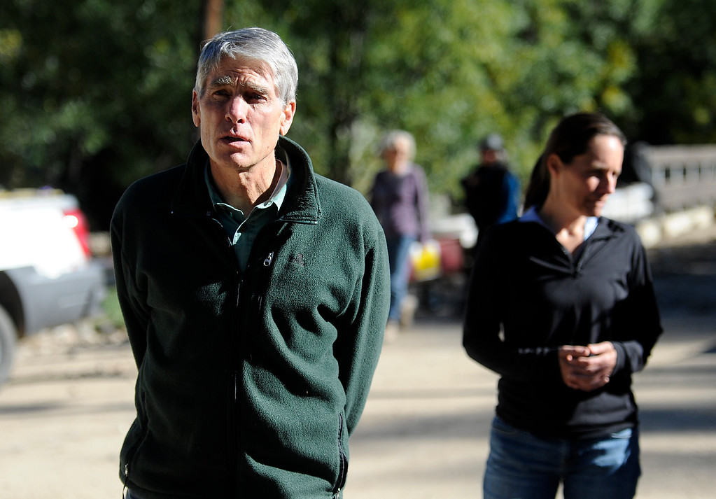 . Senator Mark Udall and Jamestown mayor Tara Schoendinger walk through the flood damage in Jamestown on Saturday, Sept. 28. For more photos and a video interview with Senator Mark Udall and residents of Jamestown go to www.dailycamera.com Jeremy Papasso/ Camera