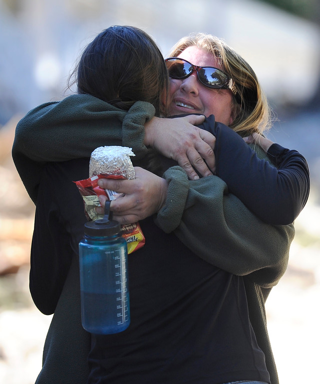 . Jamestown mayor Tara Schoendinger hugs long-time resident Laura Williams in the flood damaged town of Jamestown on Saturday, Sept. 28. For more photos and a video interview with Senator Mark Udall and residents of Jamestown go to www.dailycamera.com Jeremy Papasso/ Camera