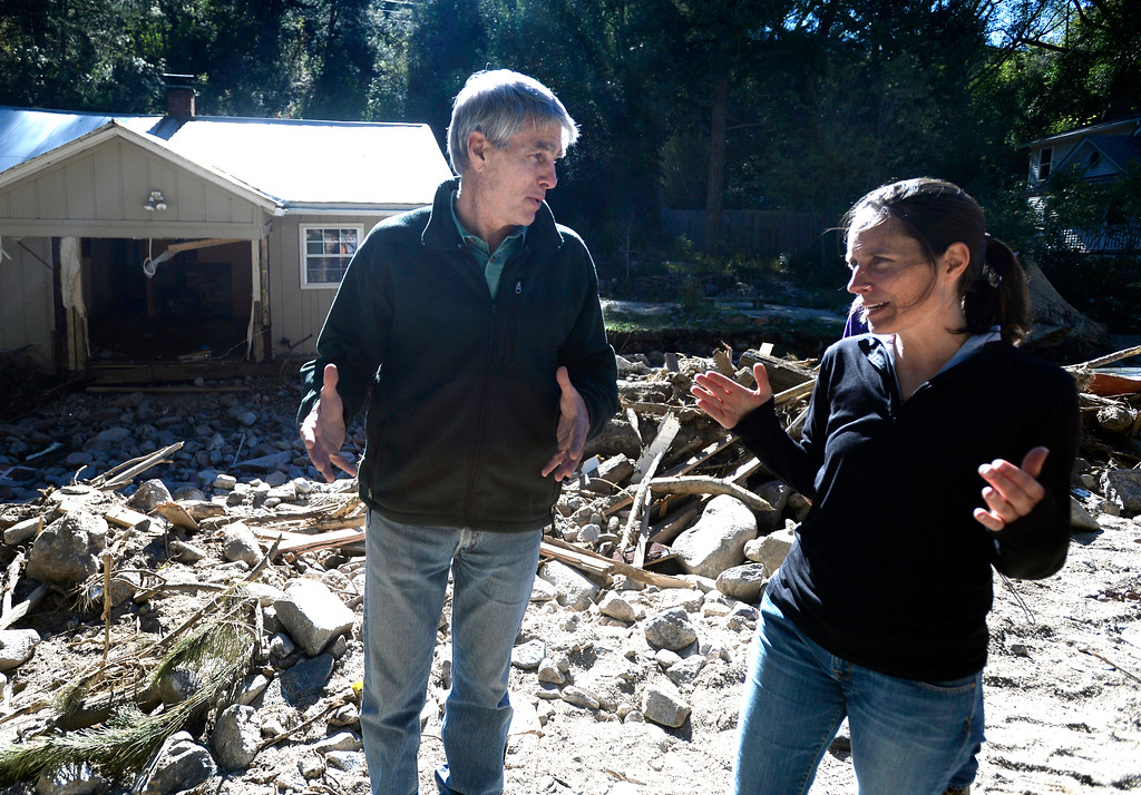 . Senator Mark Udall speaks with Jamestown Mayor Tara Schoendinger in front of a flood damaged home on Saturday, Sept. 28, in Jamestown. For more photos and a video interview with Senator Mark Udall and residents of Jamestown go to www.dailycamera.com Jeremy Papasso/ Camera