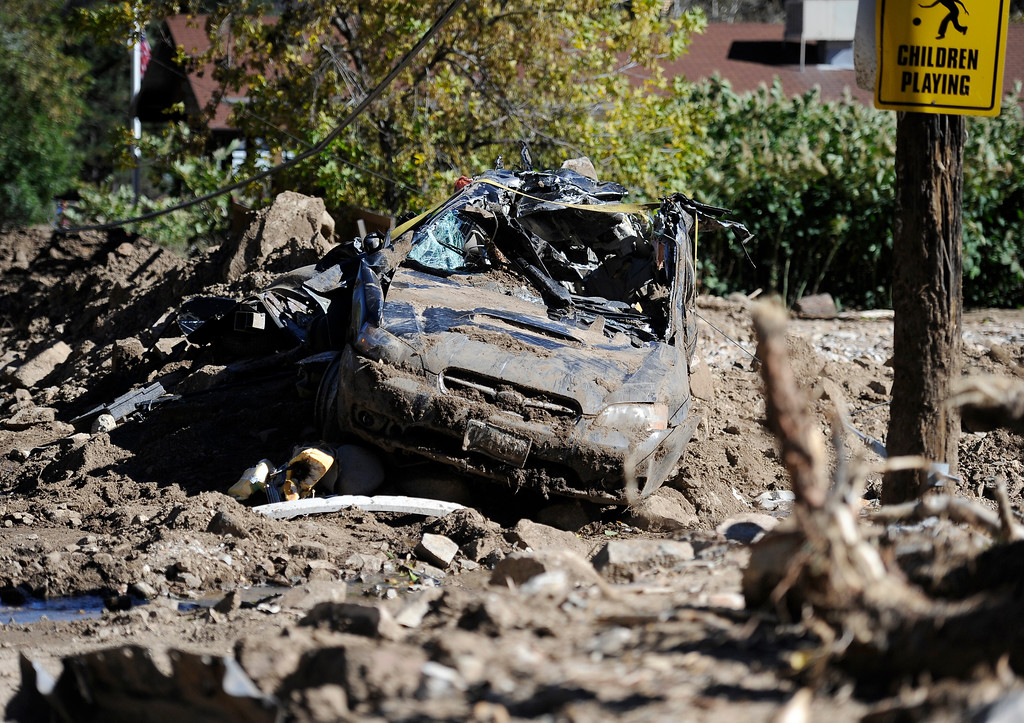 . A destroyed car sits in the mud after the flood in Jamestown on Saturday, Sept. 28. For more photos and a video interview with Senator Mark Udall and residents of Jamestown go to www.dailycamera.com Jeremy Papasso/ Camera