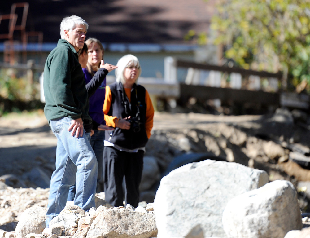 . Senator Mark Udall, at left, looks at flood damage in Jamestown on Saturday, Sept. 28. For more photos and a video interview with Senator Mark Udall and residents of Jamestown go to www.dailycamera.com Jeremy Papasso/ Camera