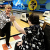 "Sue Klemoff, 62, left, gets a high-five from her friend Margie Sommers, 71, after bowling a strike during a senior bowling league on Monday, Oct. 15, at Chipper Lanes in Broomfield. For more photos and video of the bowling league go to  <a href=""http://www.dailycamera.com"">http://www.dailycamera.com</a><br />  Jeremy Papasso/ Camera"