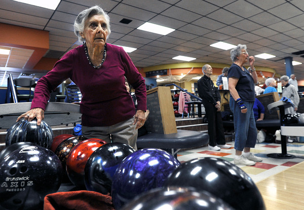 """Lucienne Paxton, 90, grabs a bowling ball while participating in a senior bowling league on Monday, Oct. 15, at Chipper Lanes in Broomfield. For more photos and video of the bowling league go to  <a href=""""http://www.dailycamera.com"""">http://www.dailycamera.com</a><br />  Jeremy Papasso/ Camera"""